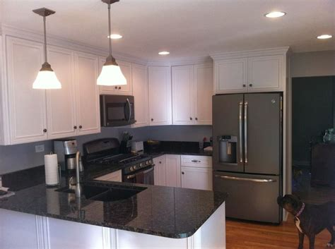 slate appliances with white cabinets and countertops