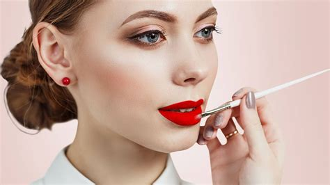 what looks good with red how to pair a bold red lip with rose gold eye shadow l