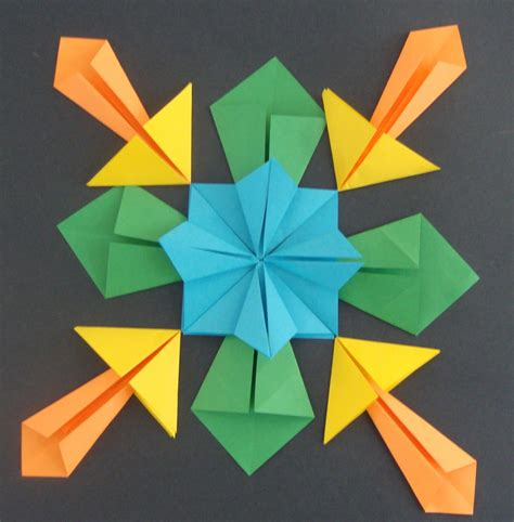 Four Origami - paper scissors glue symmetrical origami