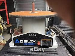 delta woodworking   boss bench oscillating spindle