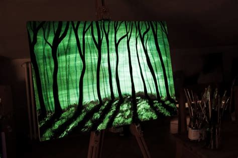 glow in the painting tree he paints some strange orange squiggles now when