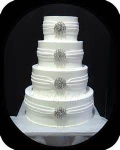 elegant white wedding cake with silver jewelry flickr photo sharing