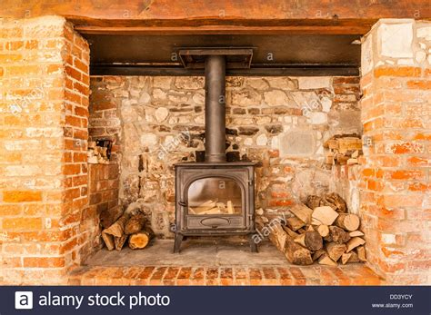 What Is An Inglenook Fireplace by An Inglenook Fireplace With A Woodburner Stock Photo