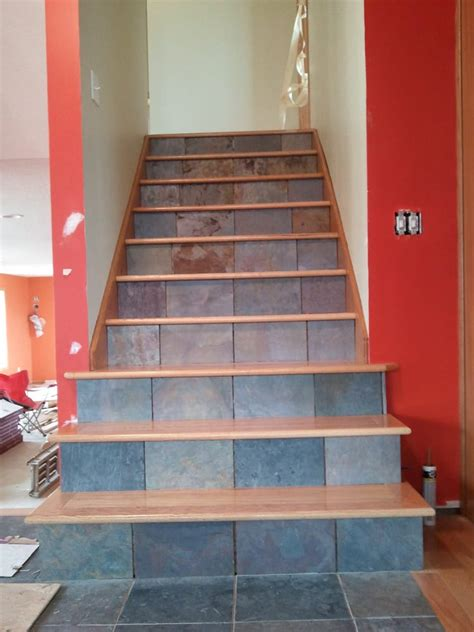 Custom staircase installation. Slate tile installed on the