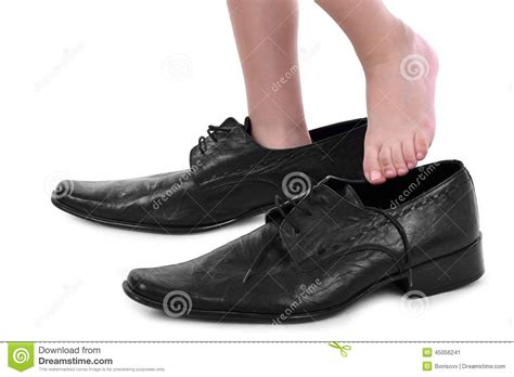 big shoes boy with big black shoes stock image image 45056241