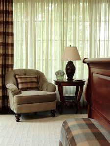 Cozy seating area in front of green curtains hgtv