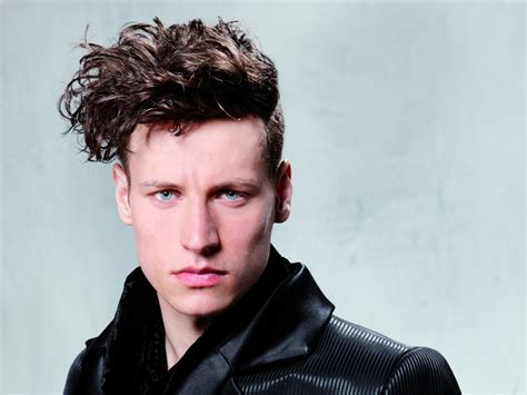 male hairstyle with undercut sides and long curly top hair