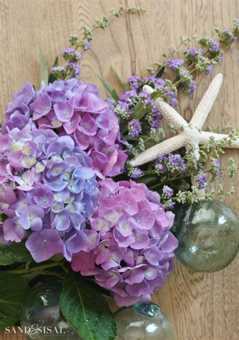 blue hydrangea flower arrangements hydrangea arrangement ideas sand and sisal