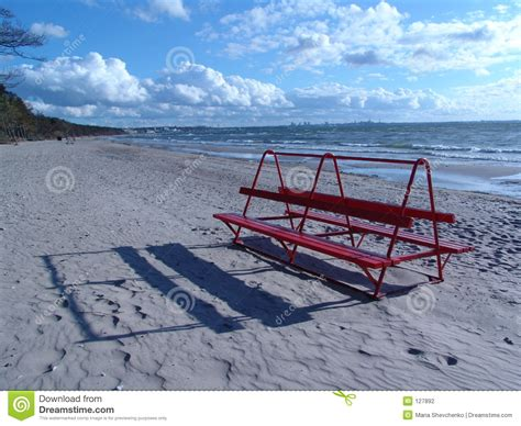 bench on the beach red bench on the beach stock photography image 127892