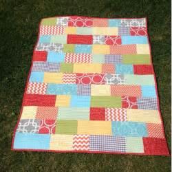 bright bricklayer crib size quilt