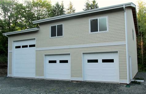 rv storage garage post frame garage with rv storage and space to live or work in on the second floor built by