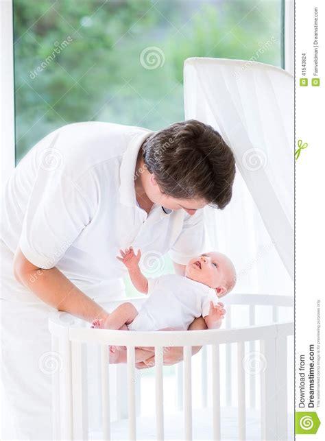 When To Put Baby In Crib Happy Putting Newborn Baby In Crib Stock Photo Image 41543824
