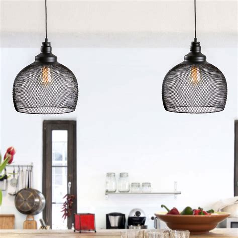 hanging pendant lights over dining table