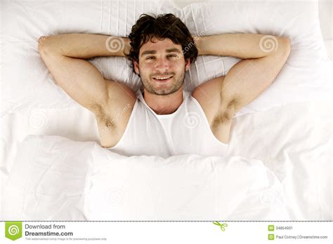 Laid In Bed by Laid In White Bed Looking Up At The Smiling