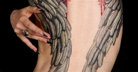 tattoo fail wings broken wings tattoo love how they quot break through quot the