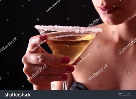 holding martini beautiful holding a martini glass stock photo