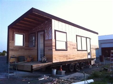 stunning tiny house built on a gooseneck flatbed trailer