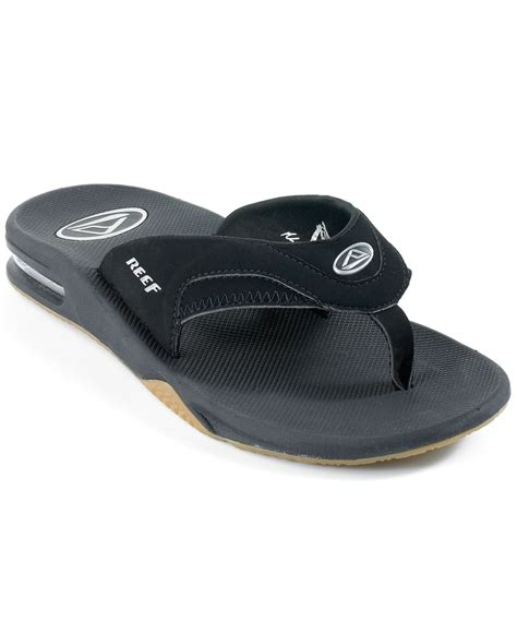 reefs sandals lyst reef s fanning sandals with bottle opener