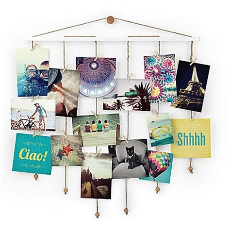 photo collage display umbra 174 dangle photo display wall collage in white bed
