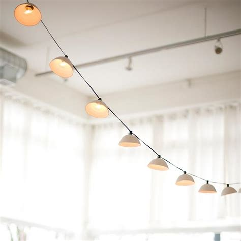 hanging string lights indoors 10 easy pieces cafe style outdoor string lights gardenista