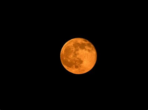 full strawberry moon strawberry moon lights up sky in rare lunar event abc news