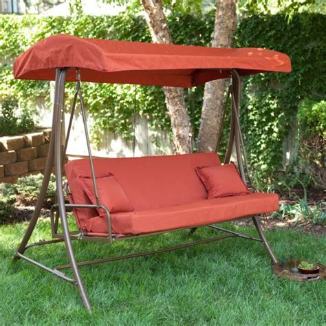 creative patio furniture swings with canopy and large rectangular cushion pads on red vinyl
