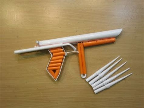 How To Make A Pistol Out Of Paper - how to make a paper cylon pistol that shoots paper bullets