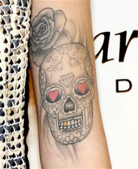 lloyd tattoos cher lloyd s mexican sugar skull and arm tattoos