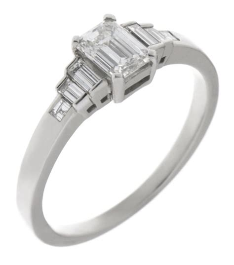 deco emerald cut and baguette engagement ring