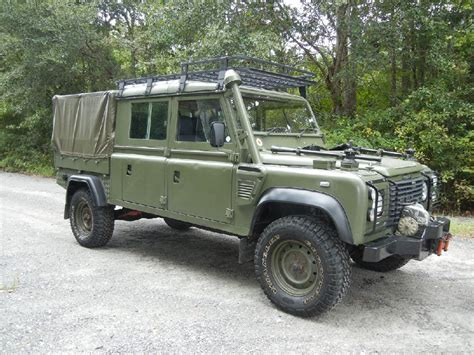 military land rover defender 130 mod style with wolves military land