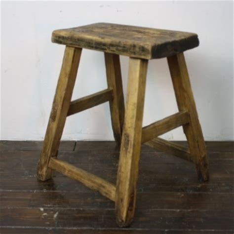 rustic varnished wooden stool v55 lovely and company