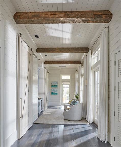 beach home bedroom with pecky cypress barn door on rails beach home bedroom with pecky cypress barn door on rails