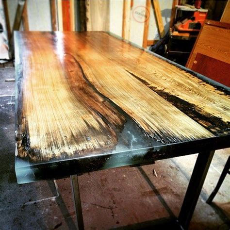 cypress slab  epoxy   grooves steel legs
