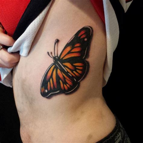 butterfly tattoo rib cage color tattoo of monarch butterfly on ribs