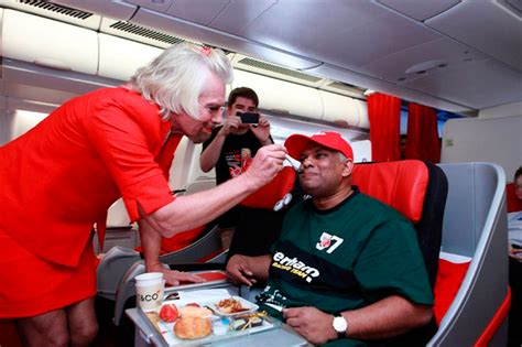 airasia redhouse richard branson shaves legs squeezes into a red skirt