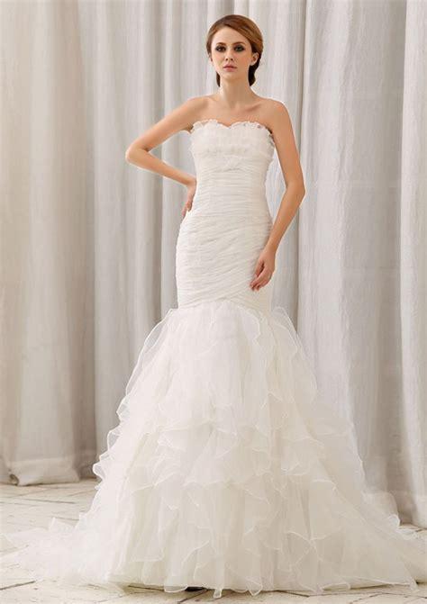 white mermaid wedding dress with ruffles and