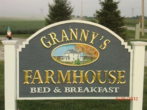 farm bed and breakfast sign in front of the farmhouse picture of grannys farm