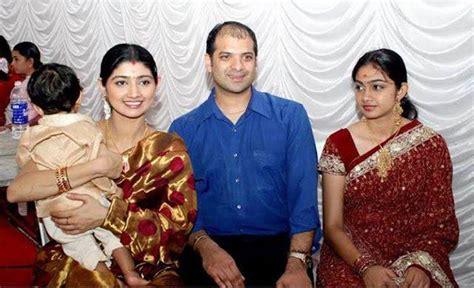 divya unni  family stills