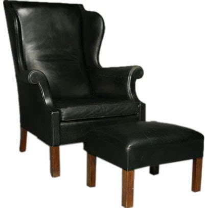 black leather chair and ottoman black leather and teak wingback chair and ottoman at 1stdibs