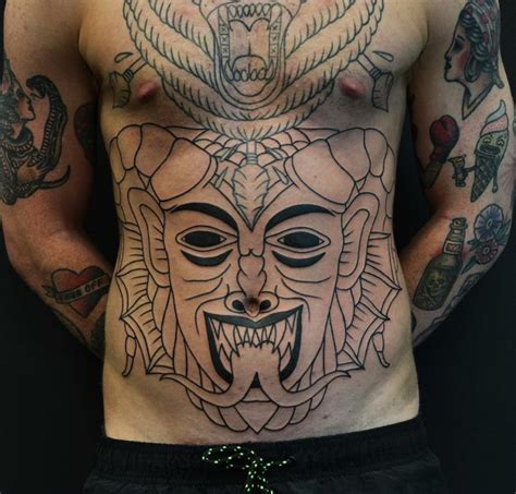 stomach tattoos for black men collection of 25 black ink stomach tattoos