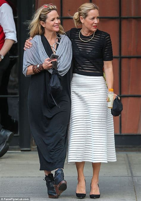 Maria Bello dotes on Clare Munn as they embrace in NYC on stroll   Daily Mail Online