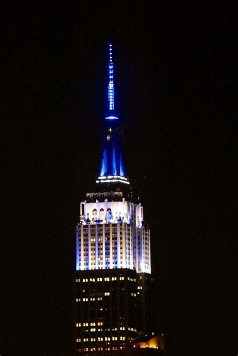 empire state building color photo empire state building lights up in new york yankees