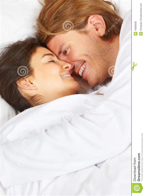how to romance a woman in bed couple showing romance on bed stock photo image 19360036