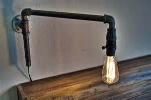 how to make pipe light fixture how to make a modern swinging wall light from iron pipe