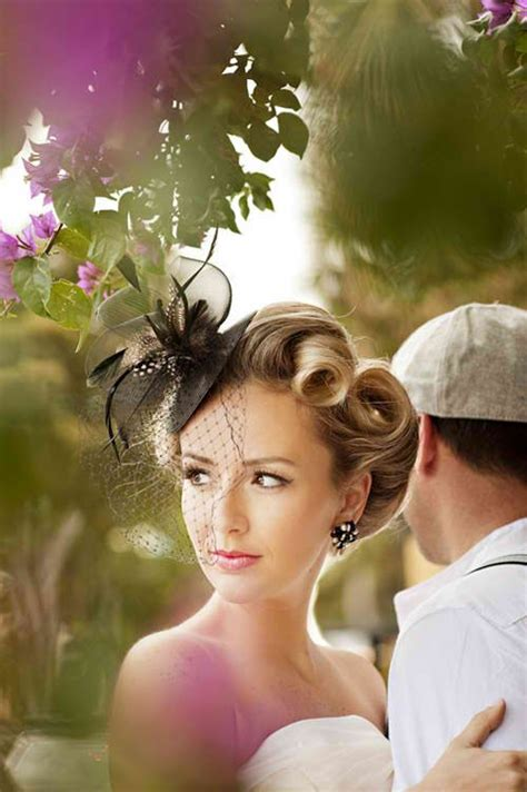 dapper brides with long hair victory roll updo with fascinator 40s hair and makeup