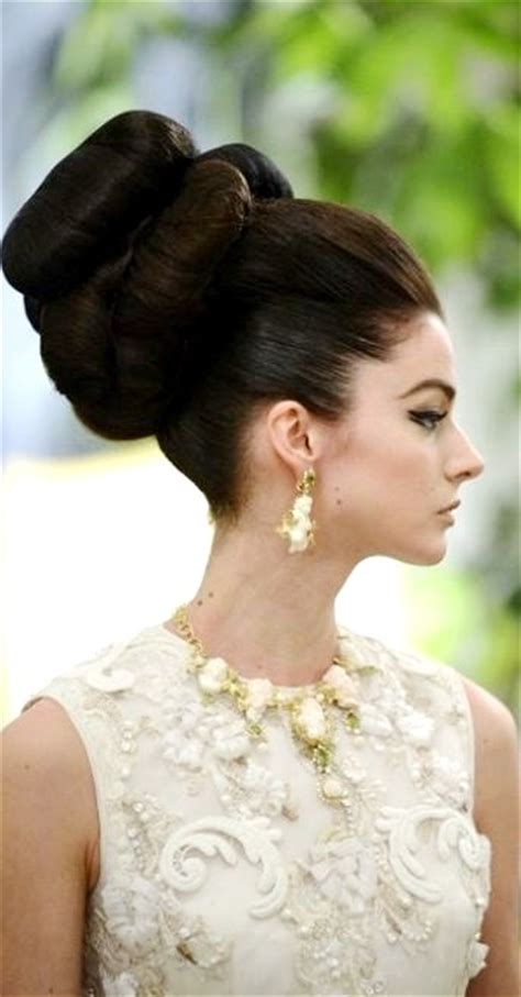 70s bun hairstyles bride s retro 70 s vintage double bun updo wedding