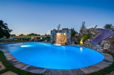 Floor And Decor Dallas Tx by Stone Oasis Luxury Swimming Pool With Grotto And Slide