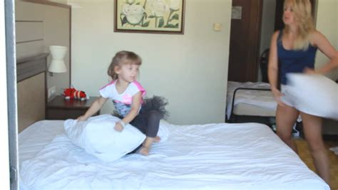 bedroom video clip cheerful family having pillow fight in a bedroom stock
