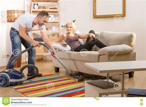 Vacuum Cleaner Untuk Sofa handsome using vacuum cleaner at home stock image