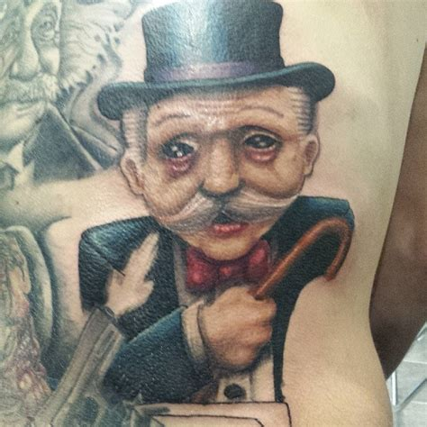 monopoly man tattoo by ronnie monopoly
